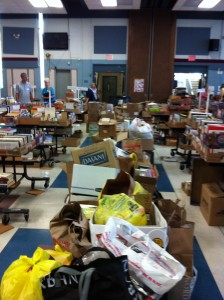 The line of book donations still to be sorted as of school closing time after our first week at the school.